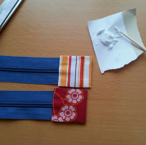 Using the fabric glue trick again on the zip tabs for the Lola pouches I'm hoping to finish today. Off to top stitch them now. #Lolapouch