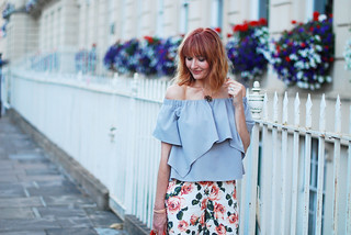 Summer style: Off the shoulder ruffle top, floral cropped trousers, orange tote | Not Dressed As Lamb