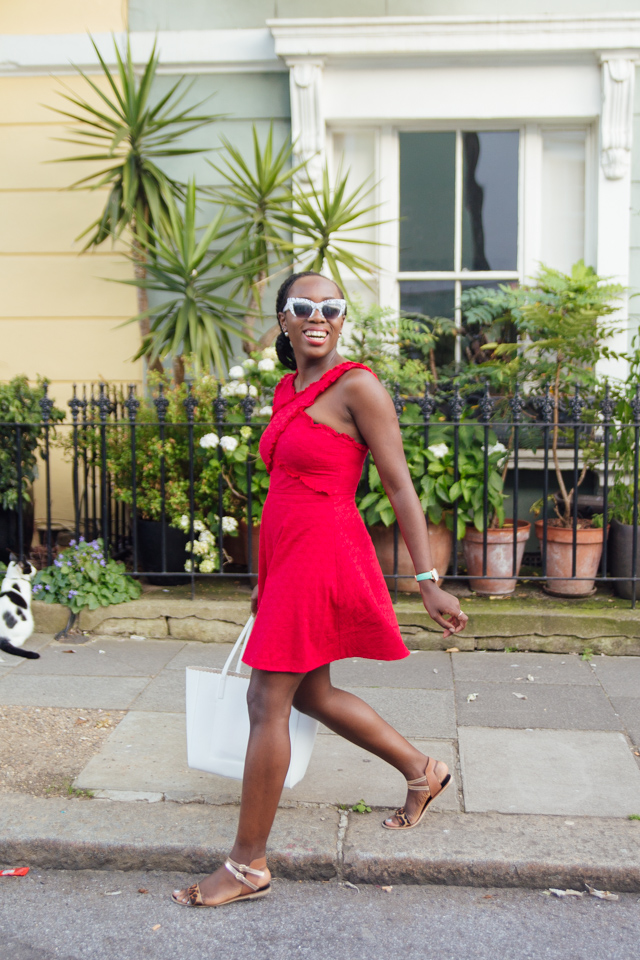 wearing a red dress with Ghana braids